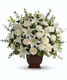 By sending this elegant arrangement to the home of those in mourning, you are letting them know they are embraced in your thoughts. And in your heart.