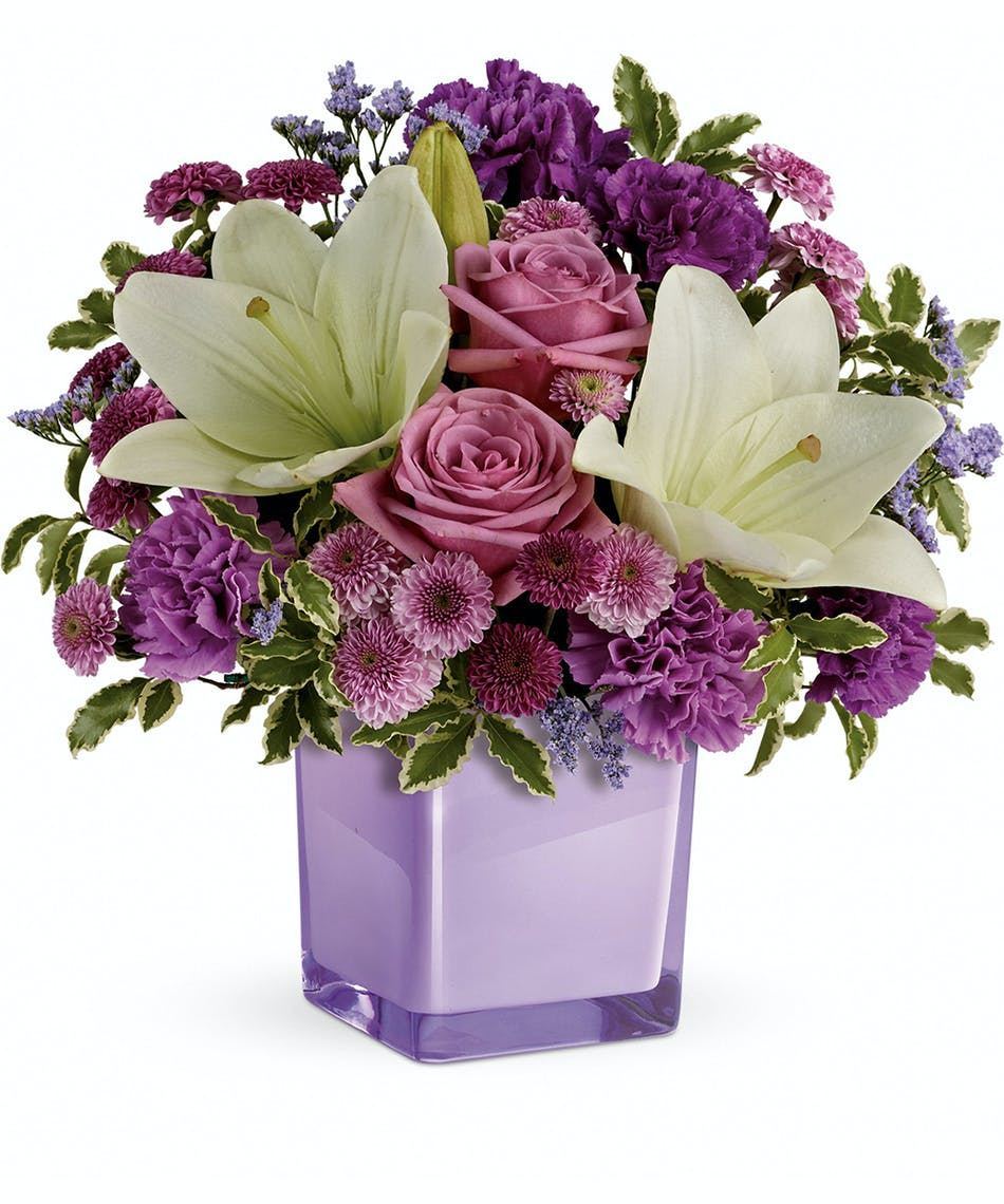 Luxurious lavender roses white lilies pueblo co flower delivery these luxurious lavender roses and crisp white lilies are poised to please perfectly presented in izmirmasajfo