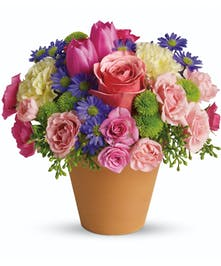 Once in a while, an arrangement is so perfect for so many people and so many occasions, it really is a floral masterpiece.